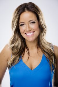 AmberMac-Headshot-Blue-Smile